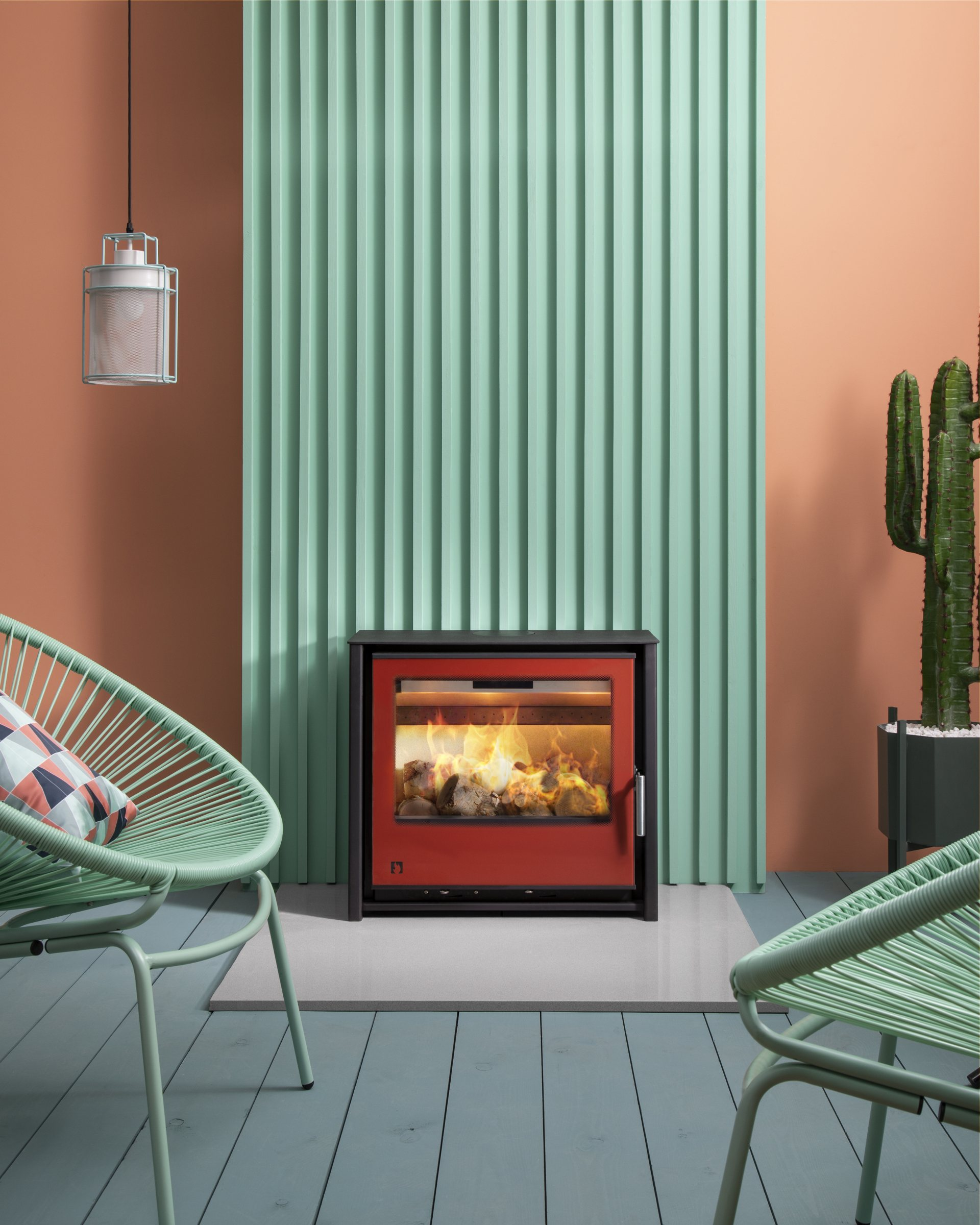 Arada i600 Slimline Freestanding Low stove in Spice red in stylish contemporary pastel-coloured room