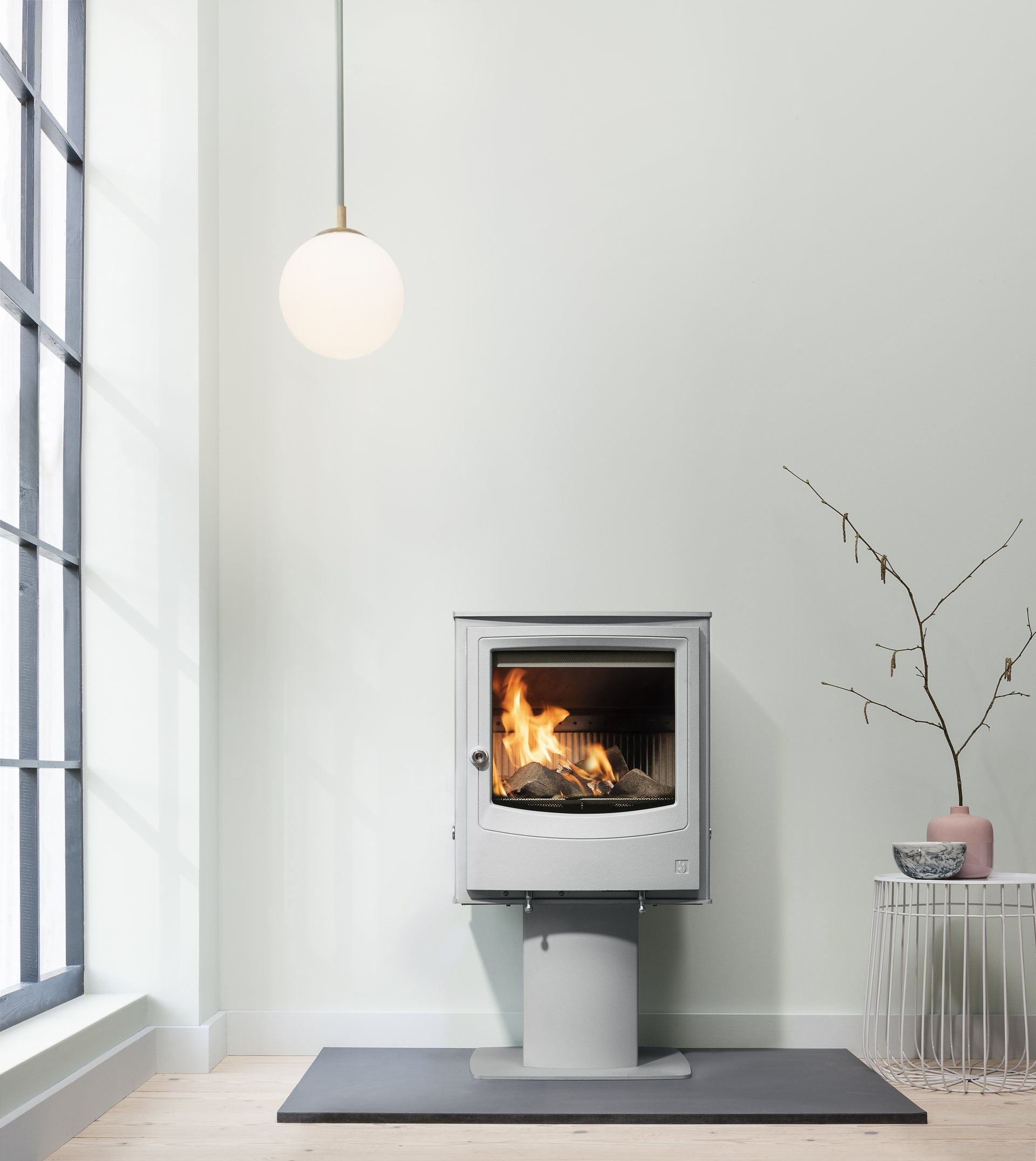 Farringdon Eco freestanding wood burning stove in Mist grey with colour-matched optional pedestal