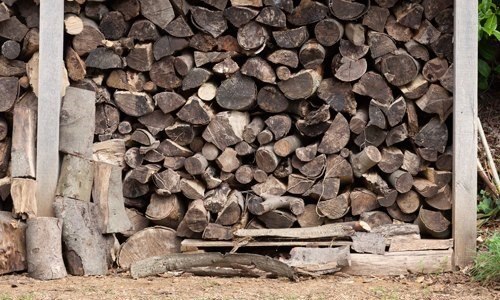 Large outdoor wood log store